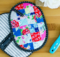 These pretty patchwork potholder pockets will keep your hands safe while looking good in the kitchen! That's right, you can toss your old oven mitts becuase these pretties are about to move in.  Not only are they easy to make but they are perfect for making in batches and giving as gifts