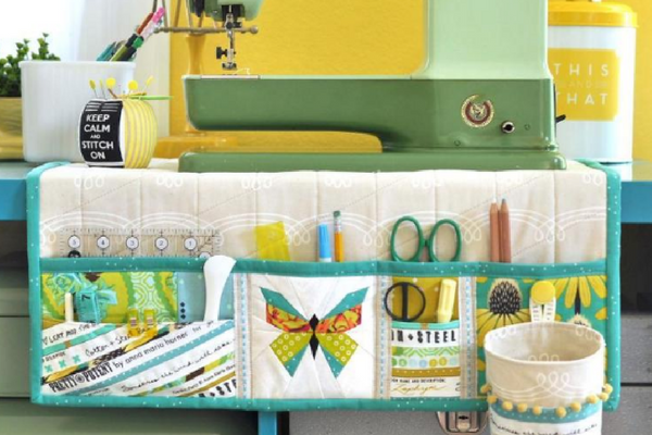 Keep your sewing space neat and tidy with a sewing mat. When your done sewing, this free pattern also doubles as a sewing machine cover.
