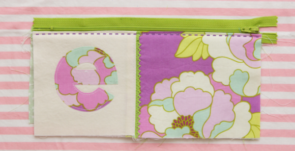 No matter what the occasion, you can give the perfect gift with this monogram applique pouch.