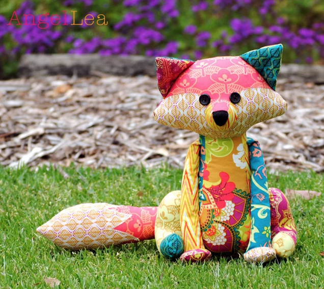Colorful fabrics make this fox sewing pattern a MUST make! Perfect for a child's toy or a sweet gift to sit on the bed.