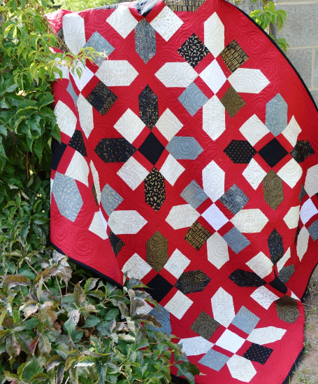Love the look of this jazz quilt block on the red background.