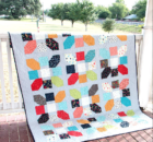 Simple quilt blocks look amazing with stitched with colorful scraps. The Jazz quilt block highlights HST's and straight stitches. Free pattern download.