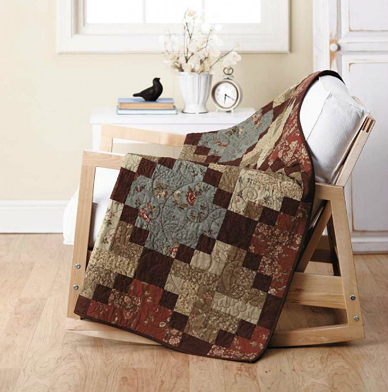 Traditional Homebound Quilt Pattern in warm colors.