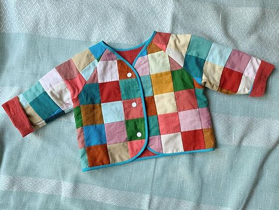 Patchwork baby jacket using the Lullaby Layette pattern by Oliver + S.