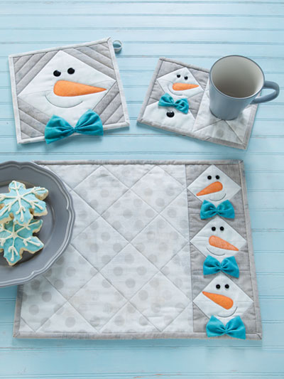 Snowman table setting sewing pattern featuring a pot holder, mug rug, and place mat