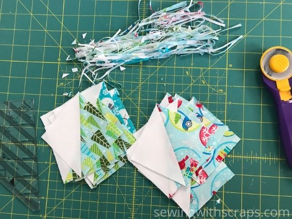 Trimming up half square triangles for the Star & Heart Present Block in the Handmade with Love quilt along.